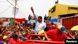 Venezuela's acting president and presidential candidate Nicolas Maduro (C) at a campaign rally in state of Barinas, April 2, 2013.