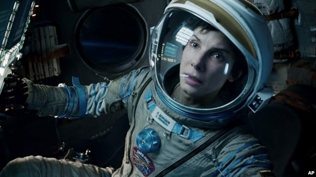 "This film image released by Warner Bros. Pictures shows Sandra Bullock in a scene from ""Gravity."" Bullock says making the lost-in-space movie directed by Alfonso Cuaron was her ""best life decision"" ever."