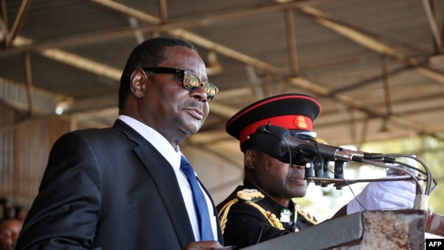 Newly elected Malawian President Arthur Peter Mutharika delivers a speech during his official inauguration as Malawi's new President, at the Kamuzu stadium in Blantyre on June 2, 2014.