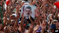 Supporters of ousted Egyptian president Mohammed Morsi protest in Cairo, Egypt, July 9, 2013.