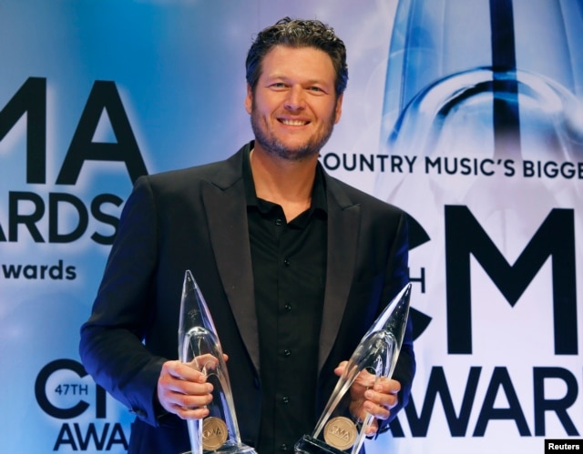 "Blake Shelton poses backstage with his Male Vocalist of the Year and Album of the Year awards for ""Based on a True Story"" at the 47th Country Music Association Awards in Nashville, Tennessee, Nov. 6, 2013."