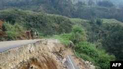 This photo taken on February 27, 2018 and received on February 28 shows damage to a road near Mendi in Papua New Guinea's highlands region after a 7.5-magnitude earthquake.