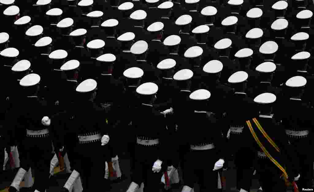Indian soldiers march during a full dress rehearsal for the Republic Day parade in New Delhi.