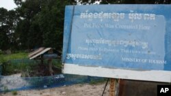 FILE - A marker stands in front of Khmer Rouge leader Pol Pot's grave at Anlong Veng, Cambodia.