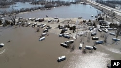This March 20, 2019, aerial photo shows flooding near the Platte River in in Plattsmouth, Neb., south of Omaha.