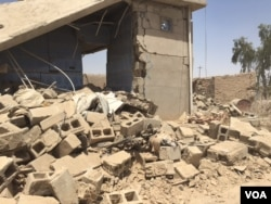 One of the houses bombed to rubble during the latest Iraqi Kurdish offensive, where Peshmerga forces retook nine villages east of the IS stronghold of Mosul, June 6, 2016. (S. Behn/VOA)
