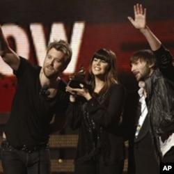Lady Antebellum, from left, Charles Kelley, Hilary Scott, and Dave Haywood accept the award for best country album at the 53rd annual Grammy Awards on Sunday, Feb. 13, 2011, in Los Angeles. (AP Photo/Matt Sayles)