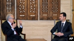 In this photo released by the Syrian official news agency SANA, Syrian President Bashar al-Assad, right, meets with UN Arab League deputy to Syria, Lakhdar Brahimi in Damascus, Syria, Dec. 24, 2012.