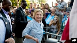 Democratic presidential candidate Hillary Clinton departs after speaking at the 49th Annual Salute to Labor at Illiniwek Park Riverfront in Hampton, Illinois, Sept. 5, 2016.