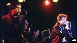 FILE- Bobby Keys on saxophone and bassist Ronnie Lane (R) join The Tremors at the Steamboat, in Austin, Texas, May 1987.