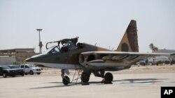 Российский истребитель на авиабазе в Багдаде. Ирак, 1 июля 2014.