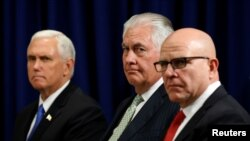 U.S. Vice President Mike Pence (L), Secretary of State Rex Tillerson (C)and U.S. National Security Adviser H.R. McMaster (R) listen as U.S. President Donald Trump meets with Ukraine President Petro Poroshenko during the U.N. General Assembly in New York, Sept. 21, 2017.