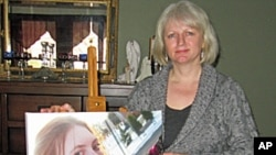 Lynne Russell holds a picture of her daughter, Siobhan, who was killed by a former boyfriend at the age of 19.