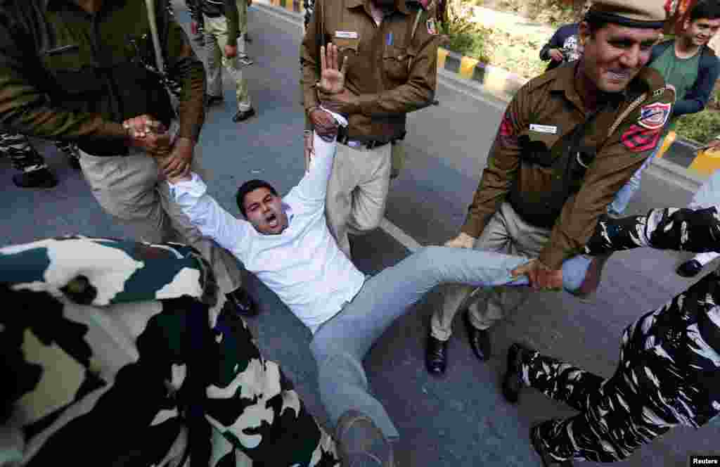 Police officers detain an activist of the Delhi Pradesh Youth Congress during a protest demanding the resignations of India's Prime Minister Narendra Modi and Defense Minister Nirmala Sitharaman, in New Delhi.