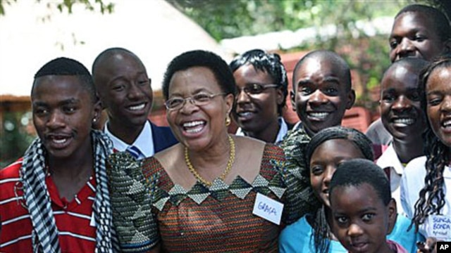 Graca Machel, wife of  Nelson Mandela, poses for a photo with children , during her visit in Harare. Machel  is in Zimbabwe to show support for the Inclusive Government in particular its efforts to uphold the rights of its children in the areas of educati