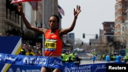 Rita Jeptoo of Kenya crosses the finish line to win the women's division of the 117th Boston Marathon in Boston, Massachusetts April 15, 2013.