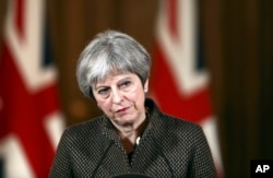 FILE - Britain's Prime Minister Theresa May is seen during a press conference in 10 Downing Street, London, April 14, 2018.