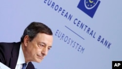 FILE - President of European Central Bank Mario Draghi speaks during a press conference following a meeting of the governing council in Frankfurt, Germany, March 10, 2016.
