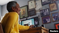 FILE - Mexican journalist Emilio Gutierrez, shown at home in Las Cruces, New Mexico, in 2011, faces deportation to his native Mexico. He fears he'll be killed there.
