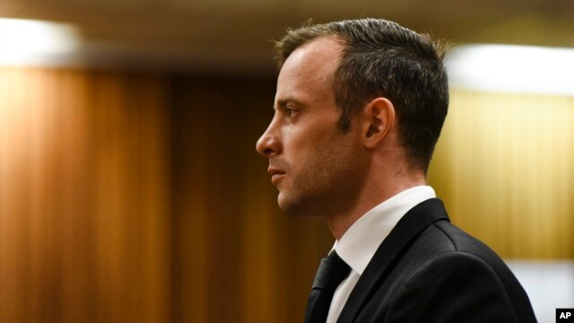FILE - Oscar Pistorius pauses in the dock at the High Court in Pretoria, South Africa, Dec. 8, 2015. The denial of his appeal clears the way for a judge to sentence Pistorius on his murder conviction at a hearing set for April 18.