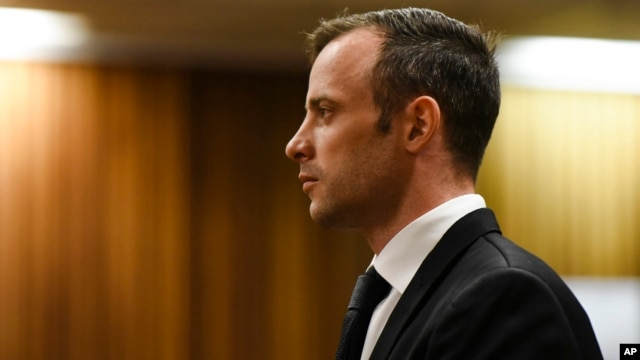 Oscar Pistorius pauses in the dock at the High Court in Pretoria, South Africa, Dec. 8, 2015.