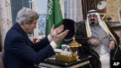 FILE - U.S. Secretary of State John Kerry, left, speaks with Saudi Arabia's King Abdullah before their meeting in Rawdat Khurayim, a secluded royal hunting retreat in Saudi Arabia, Jan. 5, 2014.