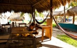 A Surf for Life volunteer crafts a desk out of local guanacaste wood in El Cuco, El Salvador.