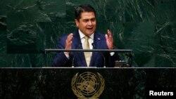 """""""Nuestro territorio es hoy uno de los principales campos de batalla de una guerra que no es nuestra. Una guerra que no iniciamos, cuyas estrategias se deciden fuera de Honduras"""", dijo Hernández."""