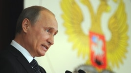 Russia's President Vladimir Putin addresses Russian Ambassadors during their meeting in the Foreign Ministry, in Moscow, July 9, 2012.