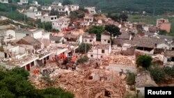 ယူနန္ျပည္နယ္၊ Ludian စီရင္စုအတြင္း ျပင္းအား ၆.၁ ငလ်င္ေၾကာင့္ ပ်က္စီးသြားတဲ့ ျမင္ကြင္း။ (ၾသဂုတ္ ၃၊ ၂၀၁၄)
