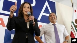 FILE - Democratic U.S. Senate candidate, Attorney General Kamala Harris gives a thumbs up to supporters during her visit to the campaign office of Rep. Ami Bera, D-Calif., in Elk Grove, Calif., Nov. 3, 2016.