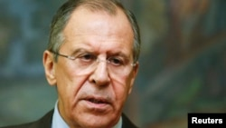 Russian Foreign Minister Sergei Lavrov speaks to reporters after a meeting with his Saudi Arabian counterpart, Saud al-Faisal, in Moscow, Nov. 21, 2014.
