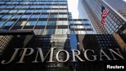 A JP Morgan Chase & Co sign is seen outside of the bank's headquarters in New York September 19, 2013.