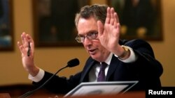 "FILE - U.S. Trade Representative Robert Lighthizer testifies before House Ways and Means Committee hearing on ""U.S.-China Trade"" on Capitol Hill in Washington, Feb. 27, 2019."