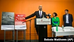 Muslim Advocates Legal Director Glenn Katon, left, and Muslim comedians Negin Farsad, center, and Dean Obeidallah, right, hold a press conference , Thursday, June 25, 2015, in New York.