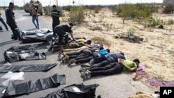 The bodies of Egyptian policemen who were killed near the border town of Rafah, North Sinai, Egypt, lie on the ground Monday, Aug. 19, 2013.