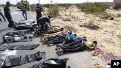 The bodies of Egyptian policemen who were killed near the border town of Rafah, North Sinai, Egypt, lie on the ground Monday, Aug. 19, 2013.