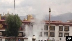 Two Tibetans carry out self-immolation protests in front of Tibet's holiest temple in Lhasa