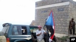 Flags of the former South Yemen are illegal in Yemeni cities, but the government does not control much of the Southern countryside; flags like this one are painted on mountainsides, rocks and buildings