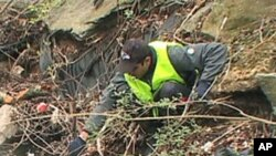 A volunteer removes trash from Boiling Brook in Maryland.