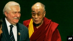 Nobel Peace Prize winner and former Polish President Lech Walesa, left, and fellow laureates the Dalai Lama, center, and Adolfo Perez Esquivel, right, greet each other in Gdansk, Poland, Friday, Dec. 5, 2008. Walesa is hosting a handful of Nobel Peace Prize laureates to mark the 25th anniversary of his Nobel Peace Prize win. (AP Photo/Czarek Sokolowski)