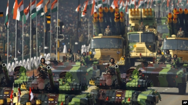 Indian army soldiers ride on T-72 tanks during the main Republic Day parade in New Delhi, January 26, 2012.