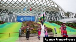 Dancers perform outside the venue of the UN Biodiversity Conference (COP 15) in Kunming, in China's southwestern Yunnan province on Oct. 11, 2021.