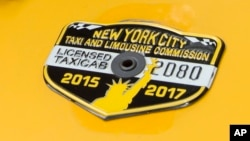 The medallion of taxi driver and taxi medallion owner Marcelino Hervias is affixed to the hood of his taxicab on New York's Upper West Side, June 26, 2017.