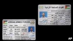 FILE - The Raqqa Media Center of the Islamic State group released a photograph of pilot Muath al-Kaseasbeh's authenticated Jordanian military identity card, Dec. 24, 2014.