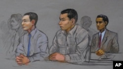 FILE - This courtroom sketch shows defendants Azamat Tazhayakov, left, Dias Kadyrbayev, center, and Robel Phillipos, right, college friends of Boston Marathon bombing suspect Dzhokhar Tsarnaev, during a hearing in federal court, May 13, 2014, in Boston.