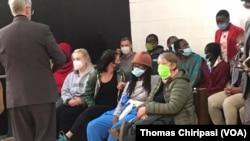 Zimbabwe activists arrive at court