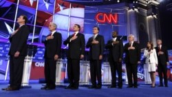 From left, Rick Santorum, Ron Paul, Rick Perry, Mitt Romney, Herman Cain, Newt Gingrich, Michele Bachmann and Jon Huntsman during the national anthem