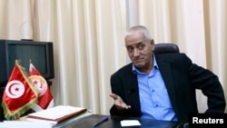 Hussein Abassi, head of Tunisia's UGTT union federation, speaks during an interview with Reuters in Tunis, Aug. 16, 2013.