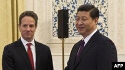 Міністр фінансів США Тимоті Ґайтнер і віце-президент КНР Сі Цзіньпін